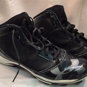 Well worn used armor all baseball shoes